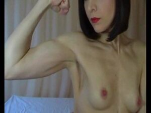 Euro Milf Flexing Her Biceps Topless