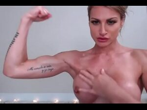 Tattooed Blonde Gets Topless And Shows Off Her Biceps