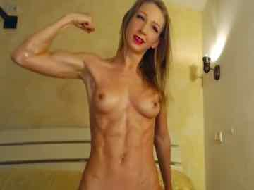 Oiled Up Fitness Cam Model Shows Her Ripped Abs And Biceps