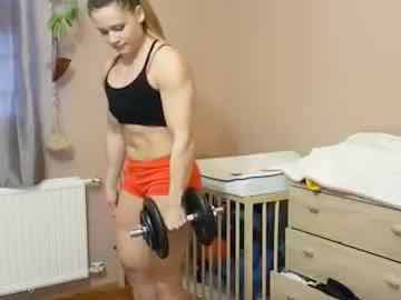 Young Female Bodybuilder Erika Darago Does Dumbbell Biceps Curl Live