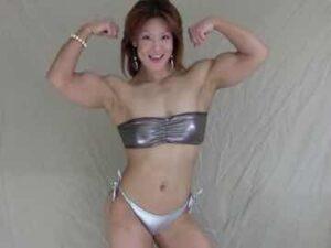 Asian Female Bodybuilder Posing In Latex Bikini