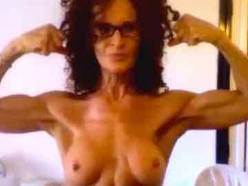 Fit Mature Woman In Glasses Stripteases And Flexes