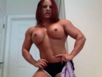 Redhead Female Bodybuilder Rips Off Her Top