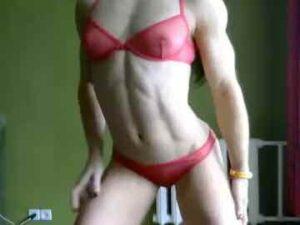Muscle Girl Dancing In Bikini