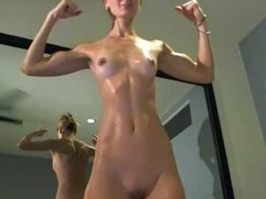 Skinny Fit Girl Oils Up And Flexes